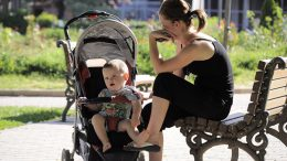 Young_mother_and_her_baby_boy_in_the_park